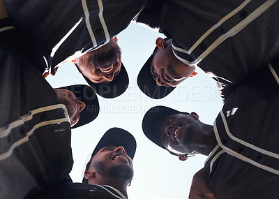 Buy stock photo Low angle shot of a group of young men huddled together at a baseball game
