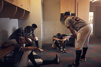 Buy stock photo Shot of a young man yelling at his fellow baseball players in a locker room