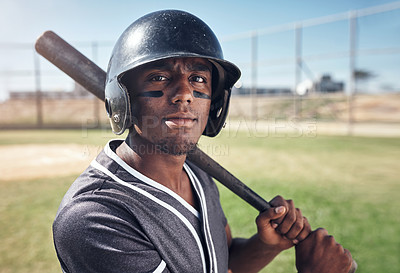 Buy stock photo Shot of a young man swinging his bat at a baseball game