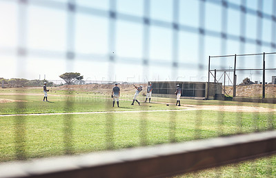 Buy stock photo Shot of a group of young men playing a game of baseball