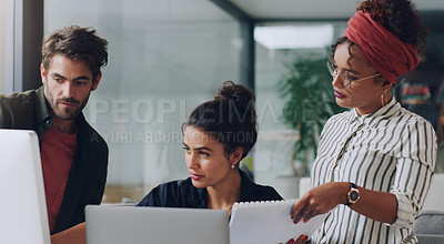 Buy stock photo Cropped shot of a group of young colleagues working together in their office