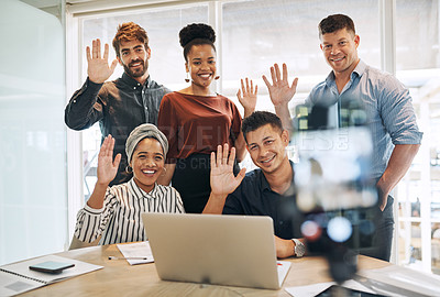 Buy stock photo Shot of a group of businesspeople waving while making a conference call on a cellphone in an office