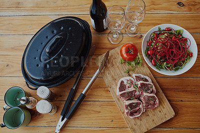 """Buy stock photo Shot of delicious food with the words """"It's braai time"""" over it"""