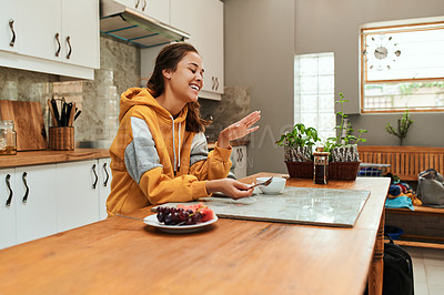 Buy stock photo Cropped shot of a young woman having fruit while sitting at home