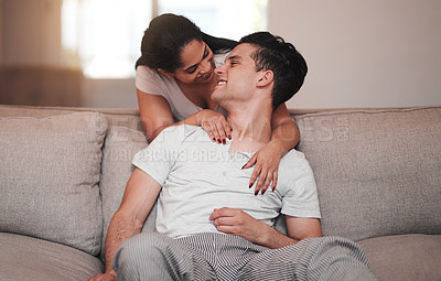 Buy stock photo Full length shot of an affectionate young couple in their living room at home