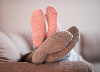 Buy stock photo Cropped shot of an unrecognizable couple's sock-covered feet