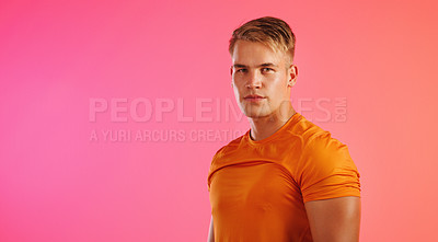 Buy stock photo Studio shot of a young man posing against a coloured background