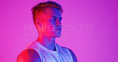 Buy stock photo Studio shot of a handsome young man posing against a purple background