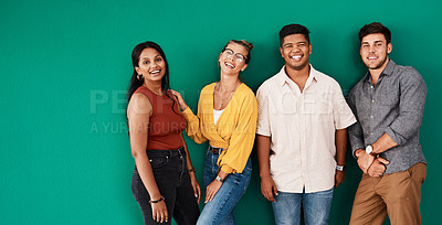 Buy stock photo Portrait of a group of young designers standing together against a green background