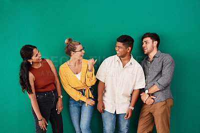 Buy stock photo Shot of a group of young designers standing together against a green background