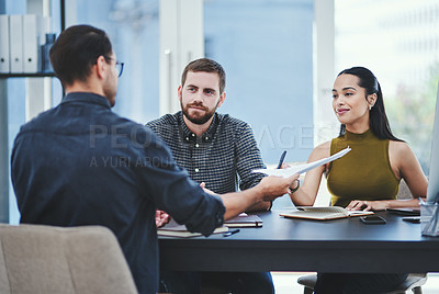 Buy stock photo Shot of a group of young designers having a discussion in an office