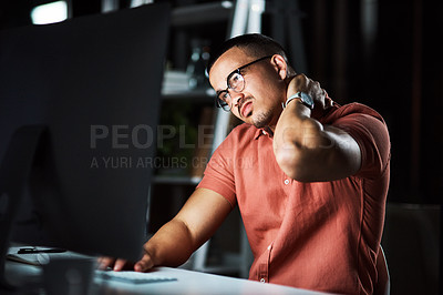 Buy stock photo Cropped shot of a businessman experiencing neck pain while working late at the office
