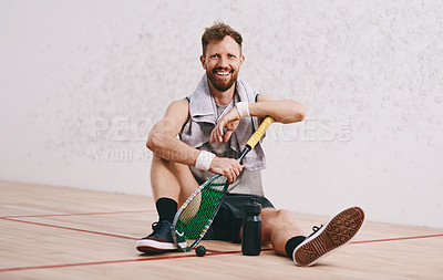 Buy stock photo Portrait of a young man taking a break after playing a game of squash