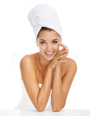 Buy stock photo A young woman wrapped in a towel touching her face