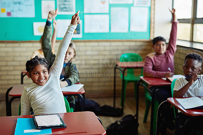 Buy stock photo Shot of young children raising their hands in a classroom