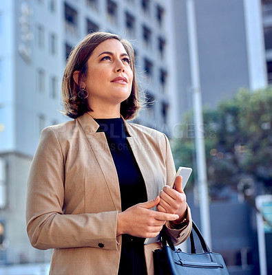 Buy stock photo Shot of a businesswoman holding a digital tablet while out in the city