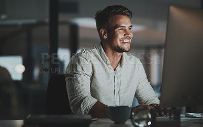 Buy stock photo Shot of a young businessman working on a computer in an office at night