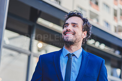 Buy stock photo Shot of a young businessman out in the city