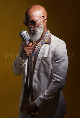 Buy stock photo Studio shot of a senior man wearing vintage clothes while singing into a microphone