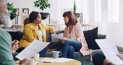 Buy stock photo Shot of two businesswomen having a discussion in an office