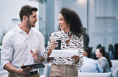 Buy stock photo Shot of a young businessman and businesswoman using a digital tablet at a conference