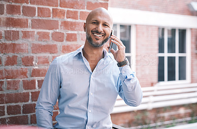 Buy stock photo Shot of a mature businessman using a smartphone outside of a modern office