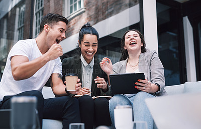 Buy stock photo Shot of a group of excited young businesspeople using a digital tablet during a meeting at a conference