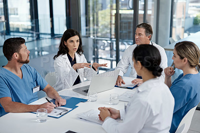Buy stock photo Shot of a group of doctors having a meeting in a modern hospital