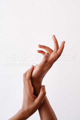Buy stock photo Studio shot of an unrecognizable woman's hands against a white background