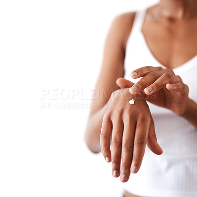Buy stock photo Studio shot of an unrecognizable woman moisturising her hands