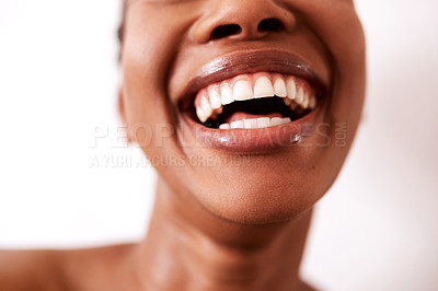 Buy stock photo Studio shot of an unrecognizable woman laughing against a white background