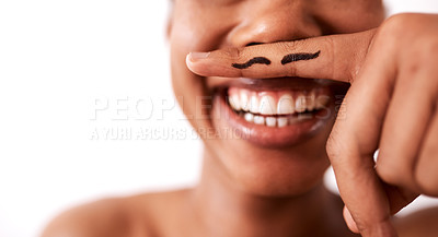 Buy stock photo Studio shot of an unrecognizable woman posing with a moustache drawn on her finger