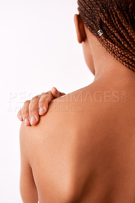 Buy stock photo Studio shot of an unrecognizable woman touching her shoulder