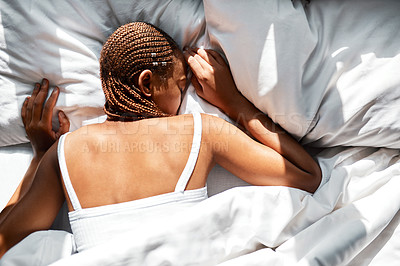 Buy stock photo Shot of a woman sleeping on her front
