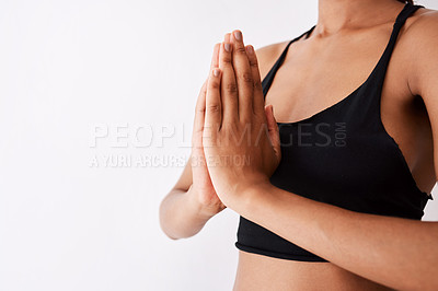 Buy stock photo Shot of an unrecognizable woman posing with her hands clasped against a white background