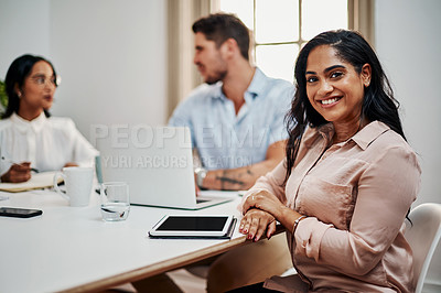 Buy stock photo Shot of a young businesswoman using a digital tablet during a meeting in a modern office