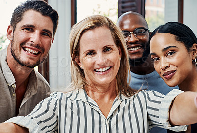 Buy stock photo Cropped portrait of a group of business colleagues taking selfies in the office