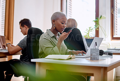 Buy stock photo Shot of a young businesswoman using a cellphone and laptop in an office