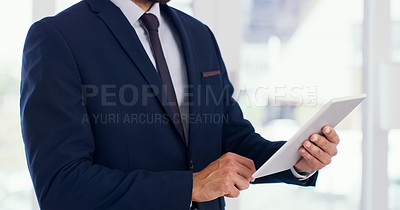 Buy stock photo Closeup shot of an unrecognisable businessman using a digital tablet in an office