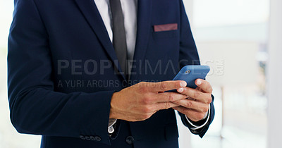 Buy stock photo Closeup shot of an unrecognisable businessman using a cellphone in an office