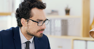 Buy stock photo Shot of a young businessman working in an office