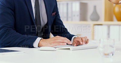 Buy stock photo Closeup shot of an unrecognisable businessman typing on a computer keyboard in an office