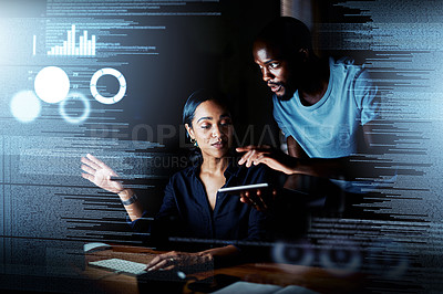 Buy stock photo Shot of two programmers using a digital tablet while working together on a computer code at night