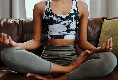 Buy stock photo Closeup shot of an unrecognisable woman meditating at home