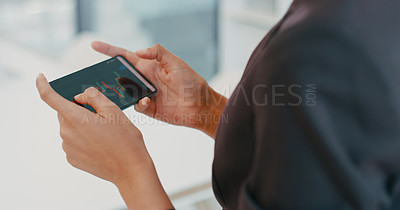 Buy stock photo Cropped shot of a businesswoman using a smartphone to analyse data in a modern office