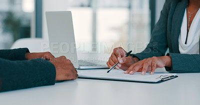 Buy stock photo Cropped shot of a businessman and businesswoman filling out paperwork during a meeting in a modern office