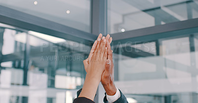 Buy stock photo Cropped shot of a group of businesspeople giving each other high five in a modern office