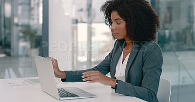 Buy stock photo Shot of a young woman disinfecting her laptop with wipes in a modern office