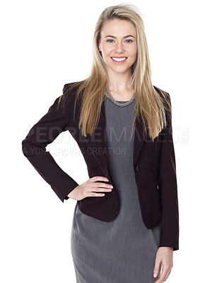 Buy stock photo Studio shot of a well-dressed young woman posing against a white background
