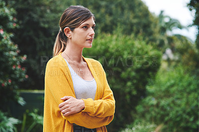 Buy stock photo Shot of a confident young woman standing in her backyard